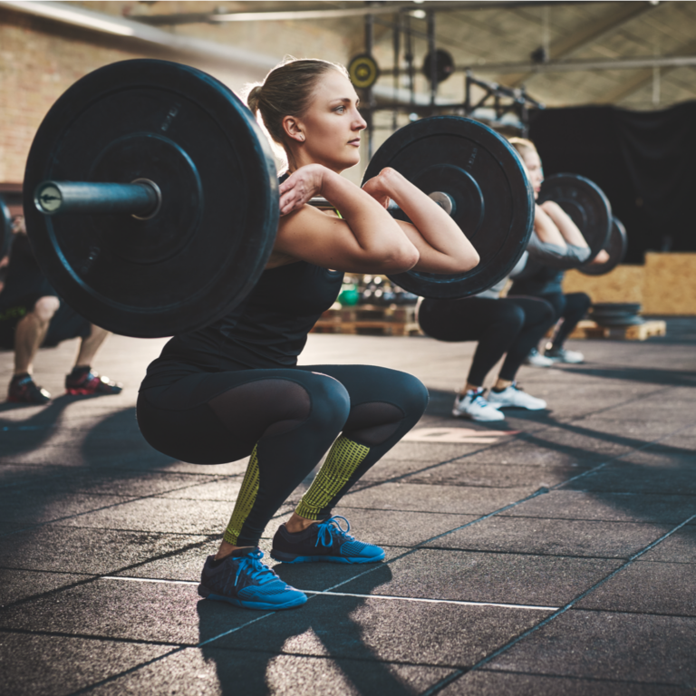 Woman lifts heavy barbell